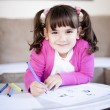 Girl drawing with markers in living room — Stock Photo #68567077