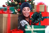 Young woman preparing gifts for Christmas, studio shots — Stockfoto