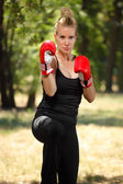 Girl boxer with gloves — Stock Photo