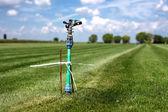 Grass garden spring sprinkle water in a row — Stock Photo