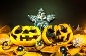 Halloween - old jack-o-lantern on black background — Stock Photo