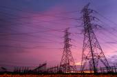 Sunset over a Silhouette electrical substation — Stock Photo