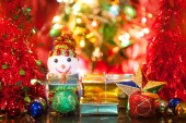 Christmas gift box with decoration — Stock Photo
