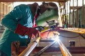 Worker welding the steel structure — Stock Photo