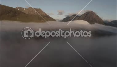 Aerial shot through cloud inversion revealing buachaille etive mor — Stock Video