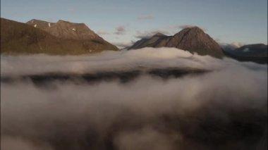 Aerial shot through cloud inversion revealing buachaille etive mor — Stock Video