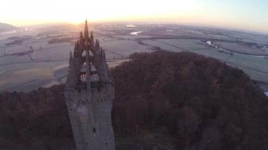 Aerial shot of the Wallace Monument in Scotland — Stock Video