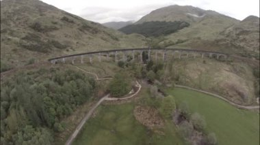 Aerial shot over Glenfinnan Viaduct in the Scottish Highlands — Stock Video