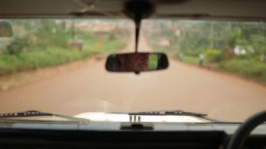 Interior shot of an old Landrover defender focussed on the rear view mirror,  Masindi, Uganda, September 2013 — Stock Video