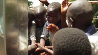 Happy African kids celebrate the installtion of a new water well in their village, Masindi, Uganda, September 2013 — Stock Video
