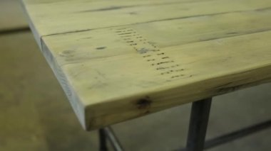 Closeup slider shot of a table made from reclaimed wood — Stock Video