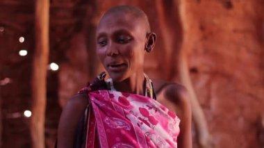 Traditional Maasai teacher pointing at black board with chalk writing, Taveta, Kenya, March 2013 — Stockvideo