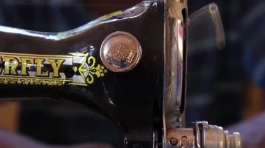 Sewing machine sewing traditional colourful fabric — Stock Video