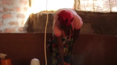 African lady tending to chicks in hatchery, Taveta, Kenya, March 2013 — Stock Video