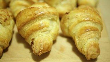 Baking croissants for breakfast — Stock Video