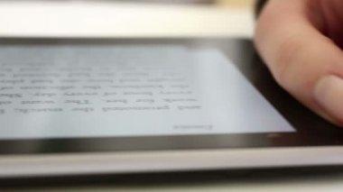 Reading on digital tablet — Stock Video