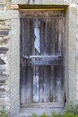 A ramshackle door — Stock Photo