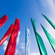 Colorful flags from below on a blue sky background — Stock Photo #72081997