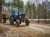 Tractor on the rural road — Stock Photo