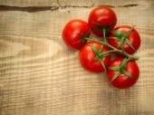 Close-up of tomatoes on wood — Stock Photo