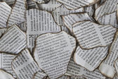 Burnt scraps of newspaper for background — Stock Photo