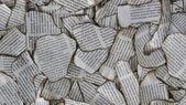 Burnt scraps of newspaper — Stock Photo