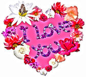 Beautiful heart with legend made of different flowers — Stock Photo