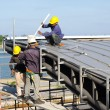 Construction worker roof installation — Stock Photo #71044643