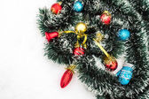 Christmas toys with tinsel snow — Stock Photo