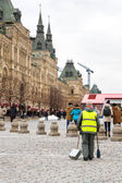 The employee at the red square. — Stock Photo