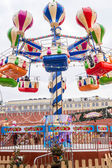 The rides at the fair on red square. — Foto de Stock
