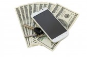 Dollars, smartphone and keys — Stock Photo