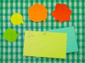 Colorful Balloons and Notes  (Green Fabric Background) — Stock Photo