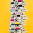 Ink cartridges exhausted stacked on yellow background — Stock Photo #68752453