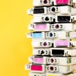 Ink cartridges exhausted stacked on yellow background — Stock Photo #68752537