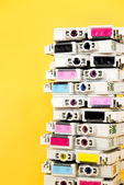 Ink cartridges exhausted stacked on yellow background — Stock Photo