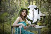 Beautiful model in the woods in a vintage scenery — Stock Photo