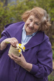 An elderly woman model in the garden — Stock Photo