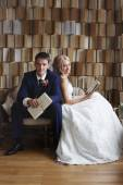 The bride and groom on the wicker furniture — Stock Photo