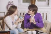 Young couple drinking tea in the discussion of ideas — Stock Photo