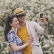 Man and woman doing their selfie on the phone — Stock Photo #73265063