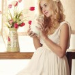 Model, woman, blonde, pregnant in the interior — Stock Photo #74414043