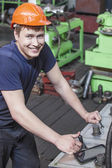 The young man working at the old factory on installation of equi — Stock Photo