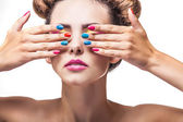 Model, a woman with bright makeup and bright nail Polish on a wh — Stock Photo