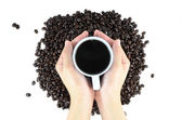 Coffee beans and Coffee drink on hand — Stock Photo