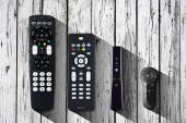 TV remote on the old wooden boards — Stock Photo