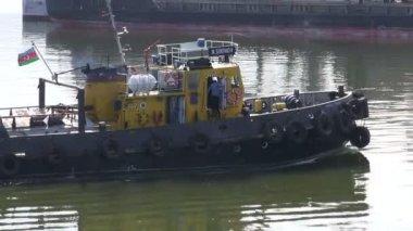 Customs boat sails towards a vessel — Stock Video
