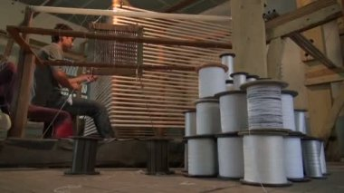 Man organizing freshly produced silk — Stock Video