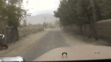 Driving through a sandstorm — Stockvideo
