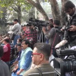 Journalists and crowds gather at a political protest — Stock Video #75032023